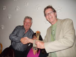 Rolf Evans (R) receives the Annual Significant Improvment Award (ASIA) 2015